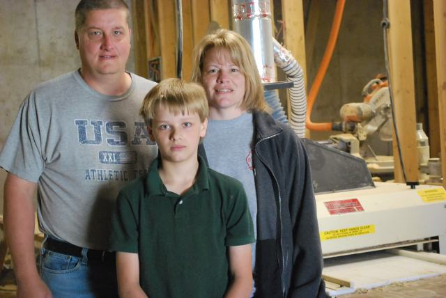 "A FAMILY AFFAIR! Scott and Angel Saylors work together in their home business. They're aided by 12-year old son, Garret. ""We do this as a family,"" says Scott. ""Me, my wife, and our 12-year old son. What part time job can you do that in?"""