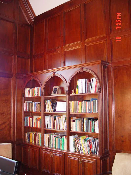 Here's Charles' walnut paneled library. He made the paneling himself with his Woodmasters and saved a bundle.