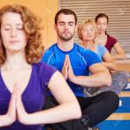 Students practice yoga poses at Woodstown Massage Boutique