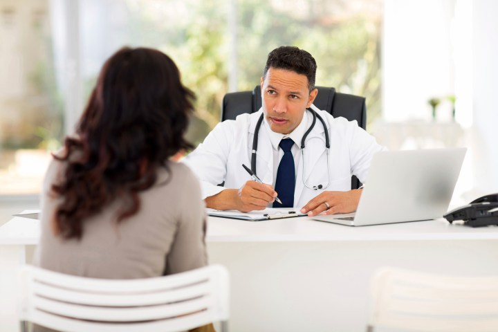 professional medical doctor consulting patient in office