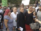 Ramsey Orta, center in suit, next to Chrissie Ortiz, speaking.WW photo: Johnnie Stevens