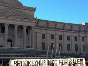 The Brooklyn Antigentrification Network protests in front of the Brooklyn Museum.