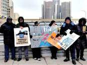 "Rank-and-file autoworkers and supporters of the Autoworker Caravan protest the ""gigantic profits"" of auto companies Jan. 10 outside the North American International Auto Show in Detroit."