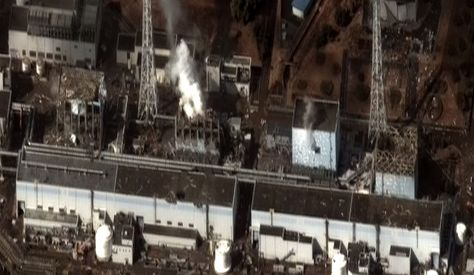 """Fukushima I by Digital Globe"" by Digital Globe - Earthquake and Tsunami damage-Dai Ichi Power Plant, Japan."