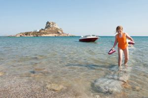 Agios Stefanos Beach - @World Travel Mama