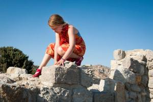 climbing 5th century ruins at Agios Stefanos Beach, Kos, Greece - @World Travel Mama