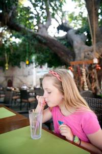 dinner beneath a giant tree strung with lanterns, Rhodes Old Town - @World Travel Mama