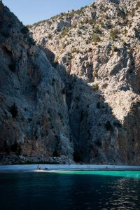 last sliver of sunlight at Agios Georgios beach, Symi, Greece - @World Travel Mama