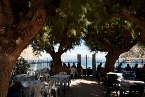 tree-shrouded cafe, Nanou Beach, Symi, Greece - @World Travel Mama