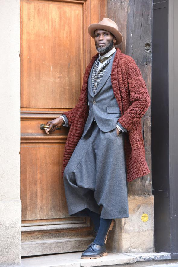 'Hand knit Spanish merino coat for IOWEYOU made by the amazing transhumancia project Made in slow worn with our 3 piece merino wool suit Hat handmade with love by @analamata. pictures by @travelight Modelled by Amah Ayivi @marchenoir_paris' - photo found here