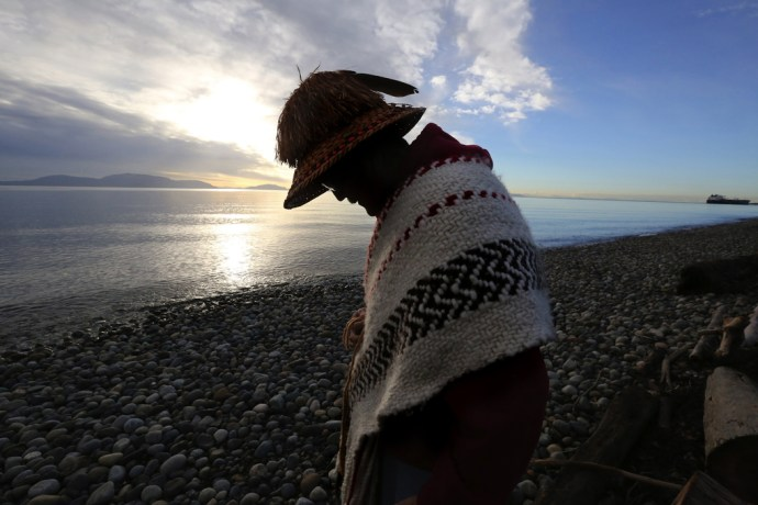 "Lummi hereditary chief Bill James, on the beach at Cherry Point, says saving it is to preserve ""the tribe's very way of life.""   It's the site of an ancient Lummi village. ref to video of James and more photos Lummi Indian tribe and opposition to development of Cherry Point into a coal export terminal.  Traditional grounds of the Lummi people.   Friday Dec. 11, 2015"