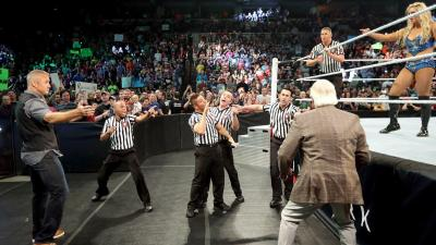 Flair comes to ringside to help Charlotte, but Shane McMahon and a series of referees come to take him from ringside.