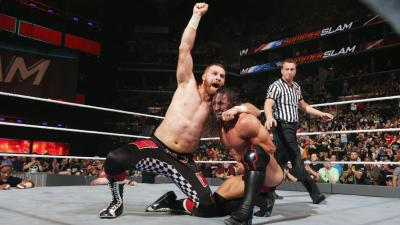 Zayn delivers a Helluva Kick, followed by Neville's Red Arrow, to clinch the win.