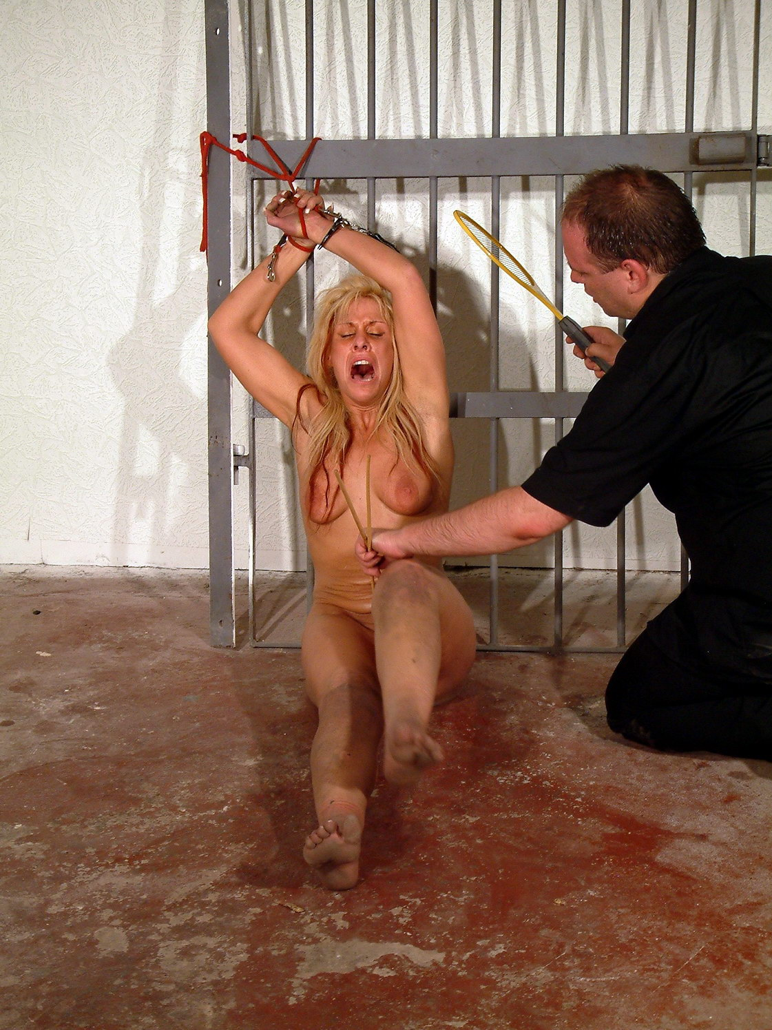 inmate in handcuffs naked