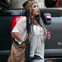 Snooki Pictured Strutting In Sky-High Heels With Her Growing Baby Bump