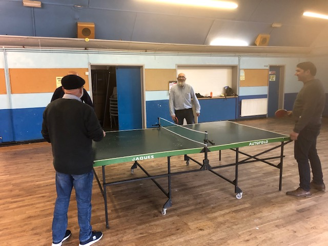 The men from Armley Mosque enjoying some table tennis doubles games!