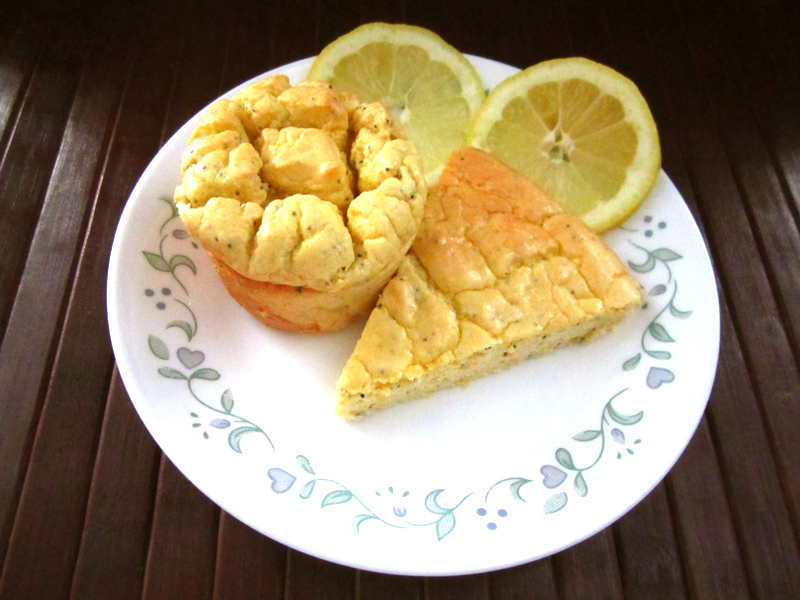 """""""picture of baked muffin and slice of cake on white plate...with slices of lemon"""""""