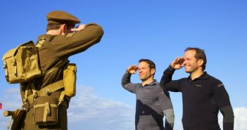 Pierre Forget and Michel Forget salute a Canadian soldier on Juno Beach on Amazing Race Canada 2 Episode 7