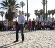 """A Little Too Much Beefcake""--Host Phil Keoghan (center) stands at the Starting Line on Venice Beach in Los Angeles, California on the season premiere of THE AMAZING RACE, Friday, Sept. 25 (8:00-9:00 PM, ET/PT), on the CBS Television Network. Photo: Robert Voets/CBS ©2015 CBS Broadcasting, Inc. All Rights Reserved"