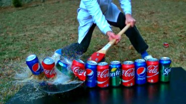 Cutting soda cans in slow motion