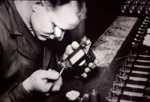 A factory worker assembles and Exakta camera.