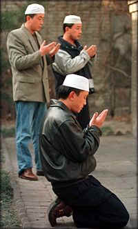 Chinese Muslims praying in Xinjiang China