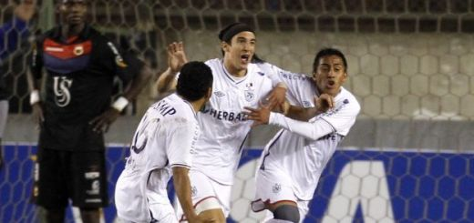 German Alemanno of Peru's San Martin and teammates Pedro Garcia and Orlando Contreras celebrate in Lima