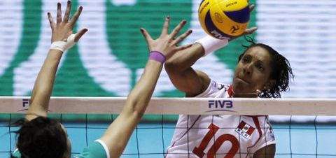 Peru's Chihuan spikes the ball against Algeria's Aissou during their first round match of FIVB Women's Volleyball World Championship in Tokyo