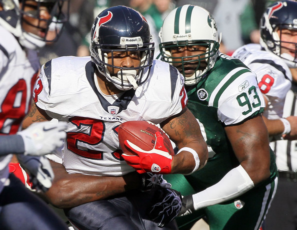 Trevor Pryce and Arian Foster - Houston Texans v New York Jets