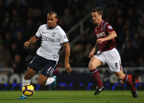 Gabriel Agbonlahor (L) of Aston Villa runs off Scott Parker of West Ham during the Barclays Premier League match between West Ham United and Aston Villa at Upton Park on November 4, 2009 in London, England.
