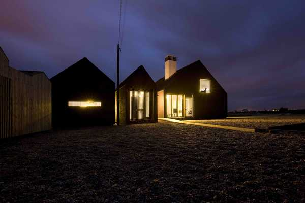 The Shingle House at night