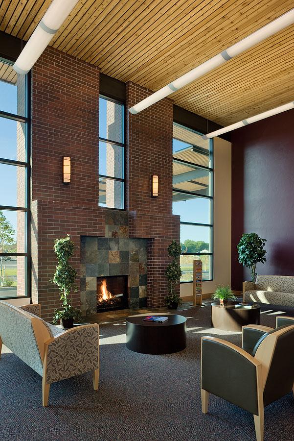 Interior, vertical, lobby waiting area with fireplace, Teton Radiology Madison, Rexburg, Idaho; Ward + Blake Architects