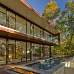 Rear Facade/Lap Pool with Fire Pit and Fully Glazed Southern Wall ©Maxwell MacKenzie
