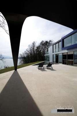View Towards Lake Geneva through the double volume external covered terrace
