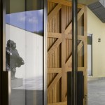 Oak shutters to the entrance (Image Courtesy Richard Bryant)