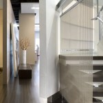 Entry with cantilevered steel stair and stainless steel mesh screen (Images Courtesy John Horner Photography)