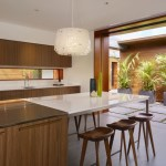 The Kitchen opens to an exterior corridor leading to one of the other 2 pods (Images Courtesy Benny Chan)