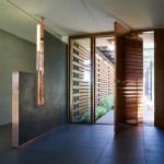 Entrance hall with custom-designed lamp (Images Courtesy Richard Barnes)