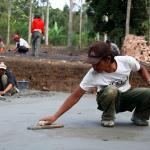Smoothening the concrete floors.