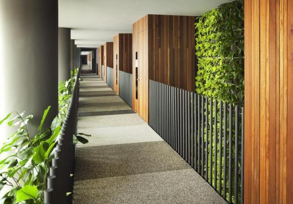 Naturally-ventilated guestroom corridor, Image Courtesy © Patrick Bingham-Hall