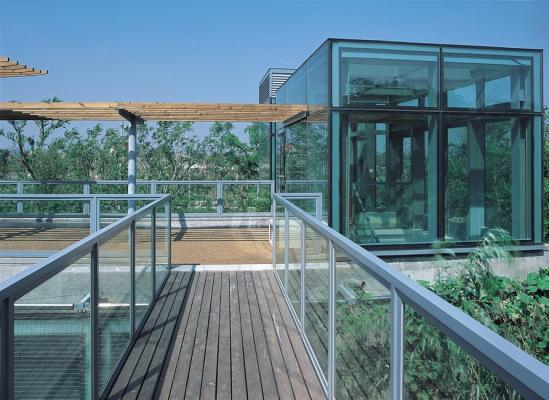 Image Courtesy © Pu Miao Architecture, From the cantilevered deck on the roof looking toward the stair tower.