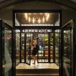 Entry through the heavy bronze and glass doors reveals a jewel box of discovery, Image Courtesy © Nikolas Koenig