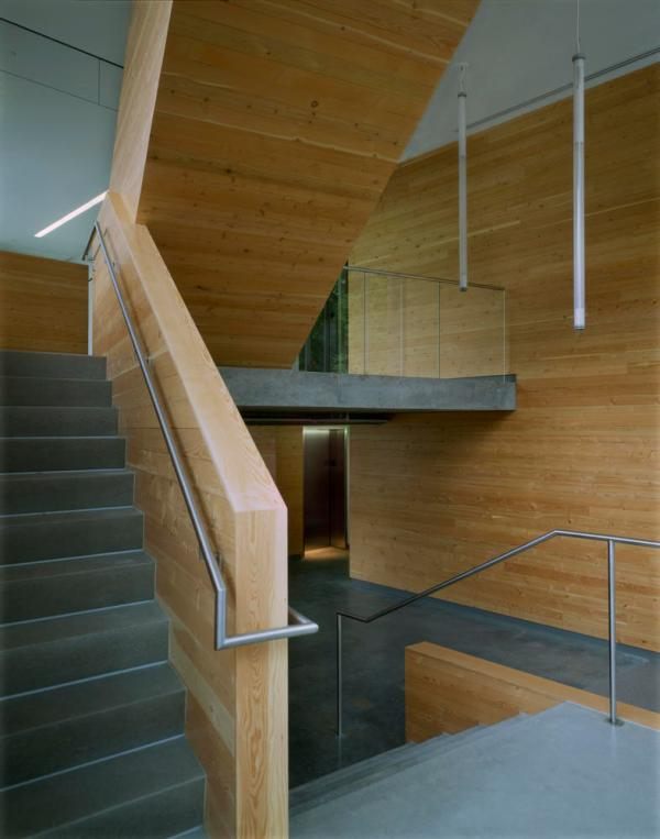 Stairwell featuring local concrete, local, FSC-certified wood, LED lights, and generous daylighting. - Photo Credit: Sally Schoolmaster