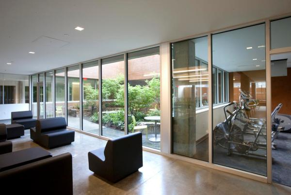 Daylighting via borrowed light from an interior courtyard implemented at one of Bud Clark Common's common spaces and exercise room. - Photo Credit: Sally Schoolmaster