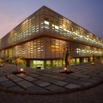External view of the building at dusk, Image Courtesy © Andre J Fanthome and Edmund Sumner