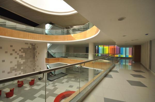 View from 2nd floor corridor over looking towards Atrium, Image Courtesy © ABIN DESIGN STUDIO