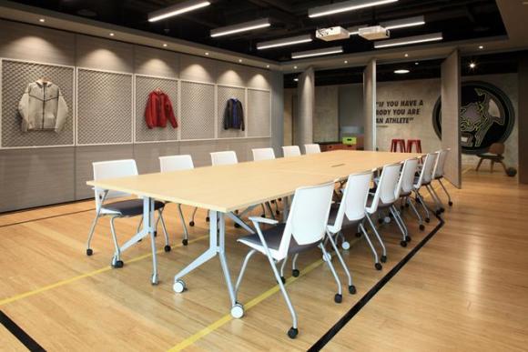 Conference room with Nike Tech-fleece walls, Image Courtesy © openUU ltd