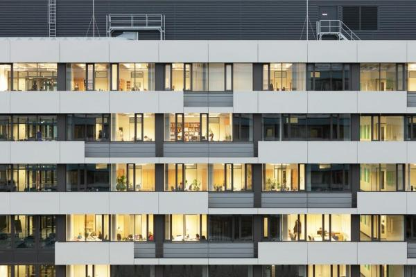 The new balconies, clad with aluminium panels, are partially closed, partially opened up, Image Courtesy © Hans-Jürgen Landes
