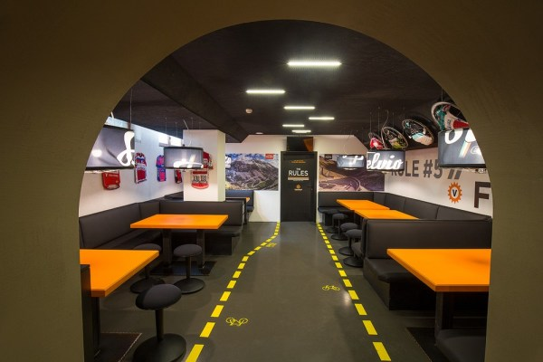 Orange, black, yellow and gray are the dominant colors of the bar, Image Courtesy © Bellotti Enrico Architects