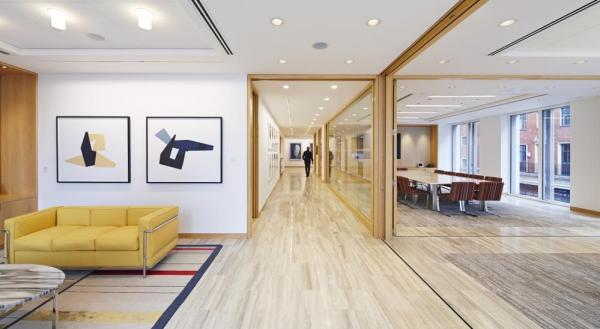 Folding pocket doors in the conference wing provide flexibility and acoustic control for simultaneous meetings and events, Image Courtesy © Paul Riddle